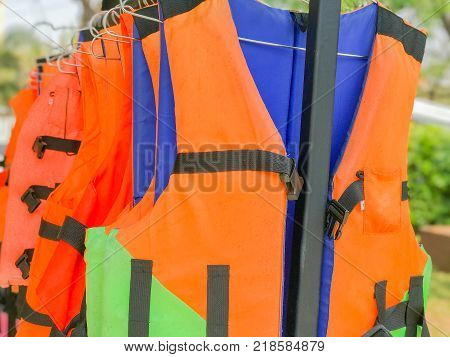 row of orange Life jacket in the park