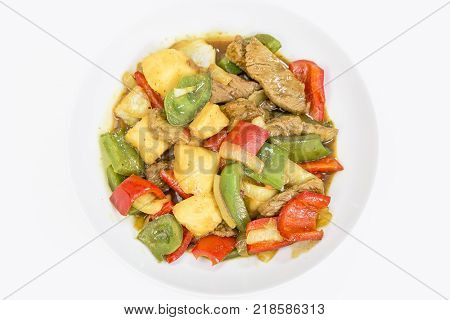 Beef in sweet and sour sauce with pineapple, paprika and onions