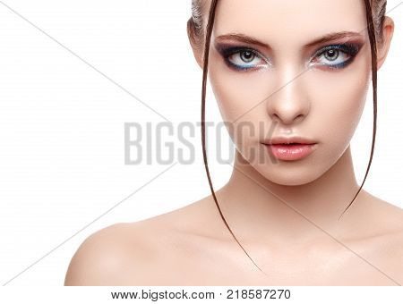 Close up half face portrait of model with glamorous makeup wet effect on her face and body high fashion and beauty creative makeup theme strobing or highlighting makeup copy space your text here