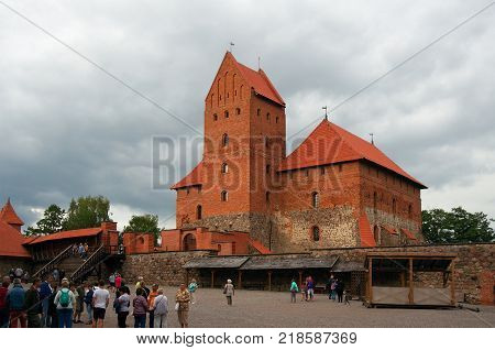 Trakai Lithuania - August 13 2017: Inner yard of Trakai castle and tourists. View of Ducal Palace and its donjon.