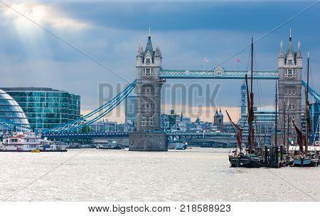 Tower Bridge beyond St. Katharine Docks, River Thames, London, England