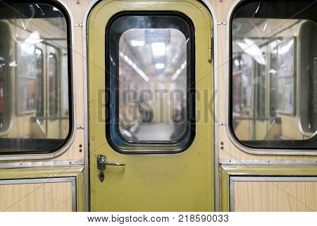 Old metro car, the door of the transition between the subway cars, underground public transport
