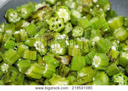 Fried bamia, okra, lady fingers or bhindi masala with onion, close-up view. Indian cuisine