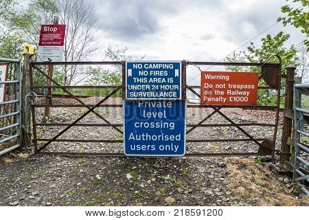 LOCH AWE, ARGYLL, Scotland - MAY 15 2017 : Sign with instructions how to tresspass the railway - Penalty 1000GBP