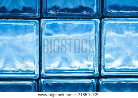 Wall of transparant glass tiles serving as colorful window wallpaper image