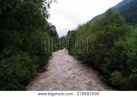 The mountain river is noisy, fast, dangerous