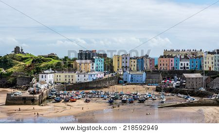 Tenby, Pemborkeshire, Wales - 08 06 2016: The beach and harbour at the seaside resort of Tenby, Pembrokeshire, Wales.