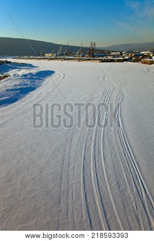 Lena river at Ust-Kut in the winter. The quay of the river port of Osetrovo on the Lena. A view of the city of Ust-Kut and the river Lena in December. Siberia Irkutsk region Russia. poster