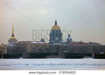 View of the historic centre and the river Neva in St. Petersburg. The building of St. Isaac's Cathedral the Admiralty and the Palace bridge in winter.