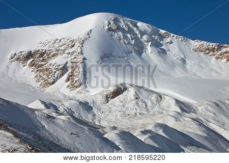 Mountain range after fresh snowfall in the mountains of Tien-Shan. The mountainous landscape of Kyrgyzstan.