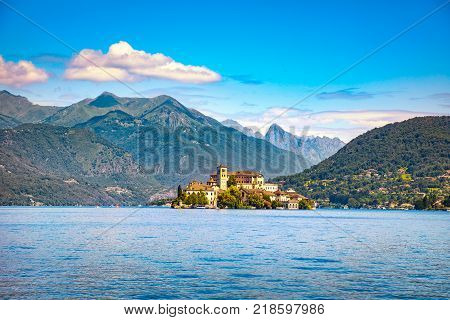 Orta Lake landscape. Orta San Giulio village island Isola S.Giulio and Alps mountains view Piedmont Italy Europe.