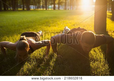 family outdoor sport together workout background concept. pair training. sportsman spouses lifestyle.