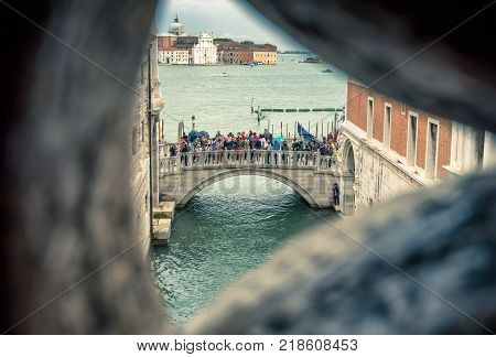 Venice, Italy - May 20, 2017: Venetian view from famous Bridge of Sighs at the Doge`s Palace. Bridge of Sighs (Ponte dei Sospiri) is the way from the palace to the prison.