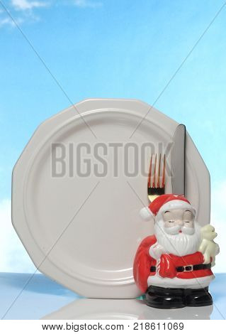 happy Merry X mas cute santa doll and empty white plate.