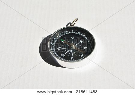 Compass on a white background. A navigation tool designed for orientation.