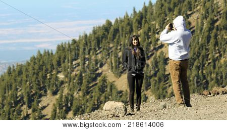 FLAGSTAFF, ARIZONA, OCTOBER 10. Arizona Snowbowl on October 10, 2017, near Flagstaff, Arizona. A Couple Takes Cellphone Photos Near Arizona's Highest Peak Humphreys Peak in the San Francisco Peaks near Flagstaff in Arizona.
