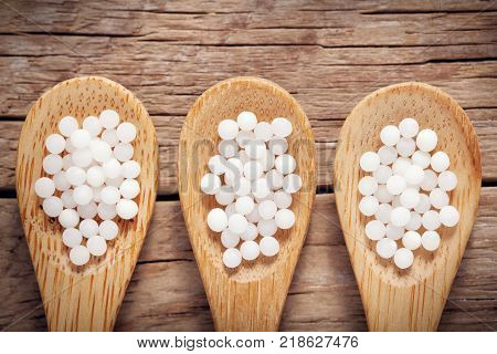 Three Woodens Spoon Of Homeopathic Globules. Homeopathy Medicine.