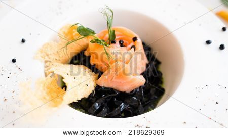 italian food black pasta nero recipe concept. traditional kitchen. national cuisine. delicious delicacy.