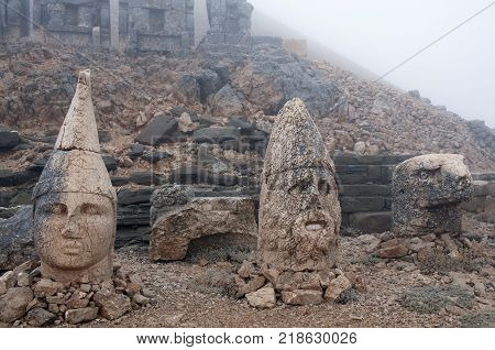 Ancient stone statues on the top of Nemrut mount Anatolia Turkey. In 62 BC King Antiochus I Theos of Commagene built on the mountain top a tomb-sanctuary flanked by huge statues 8-9-metre-high