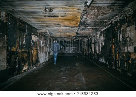 After fire in underground crossing, burned tunnel. Charred walls of corridor