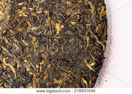 Old Shu Puerh Chinese fermented black tea, top view, macro photo