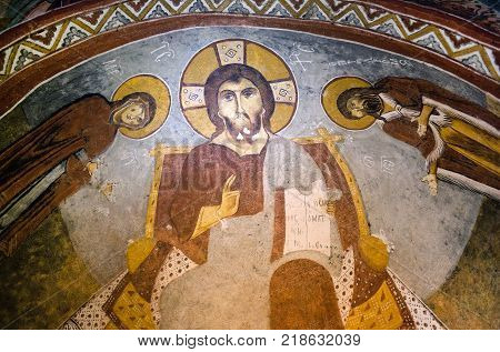 GOREME, TURKEY - MAY 16, 2016: Christ Pantocrator - ancient mural painting in Dark Church in Anatolia province