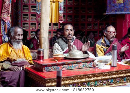 NGARI, TIBET, CHINA - APRIL 28, 2013: Buddhist monks praying during Puja ceremony in Chiu Gompa, Western Tibet