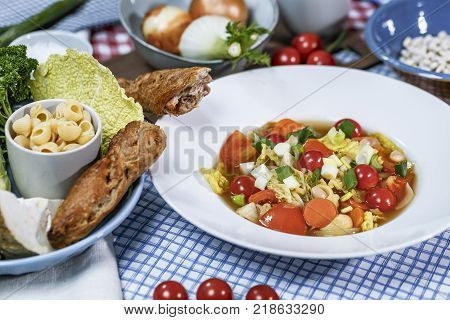 Minestrone with Savoy cabbage, carrots, white beans, Cobbettis and tomatoes