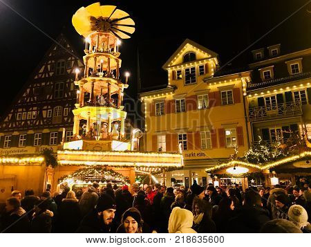 Esslingen, Germany - December 01, 2017: People enjoy the beautiful medieval Christmas Market at night in Esslingen, Germany.