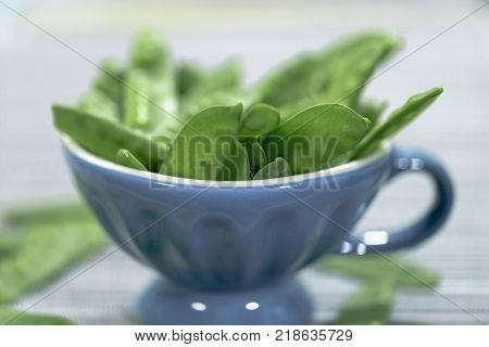 Sugar pods with grey background and blue Cup