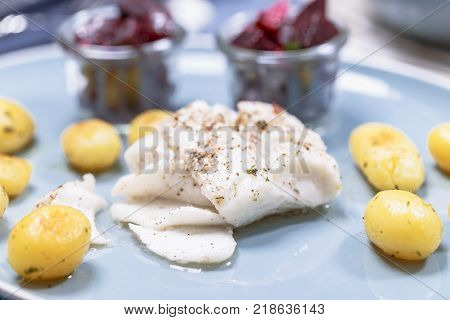 Fried cod fillet with roasted potatoes and beetroot salad