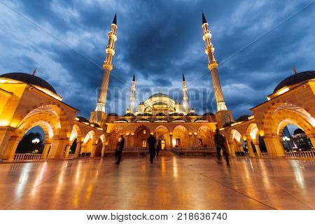 the majestic Moslem mosque shines, under the evening sky