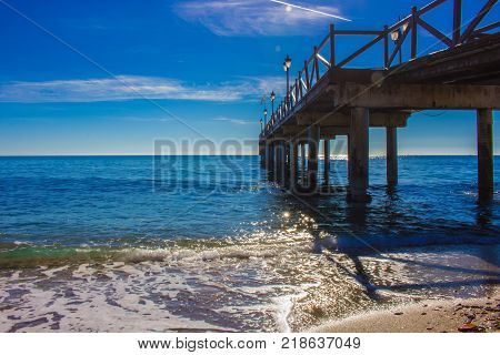 Pier. Wooden pier in Marbella. Malaga province, Costa del Sol, Andalusia, Spain. Picture taken - 14 december 2017.