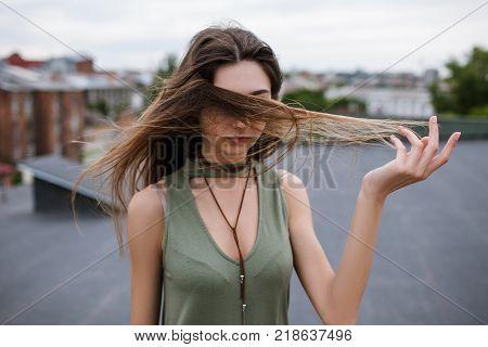 Stranger pretty woman walking on the roof. Hiding secrets.