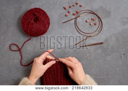 Close-up of hands knitting. Process of knitting.