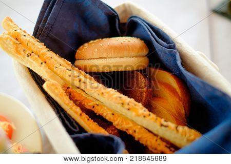 Traditional Italian snack, bread - grissini. Rolls for burgers