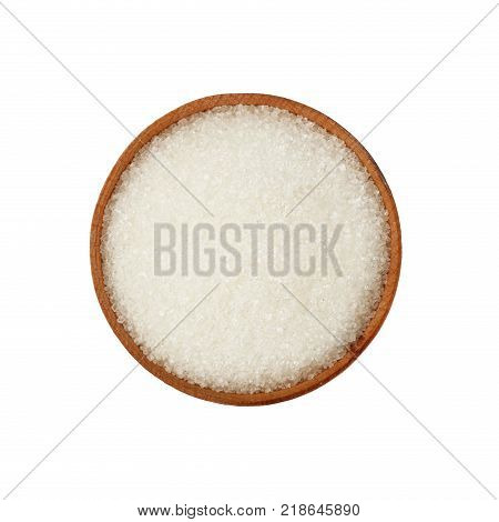 Close up one wooden bowl full of white sugar isolated on white background elevated top view directly above