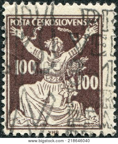 CZECHOSLOVAKIA - CIRCA 1920: A stamp printed in the Czechoslovakia shown Czechoslovakia Breaking Chains to Freedom circa 1920