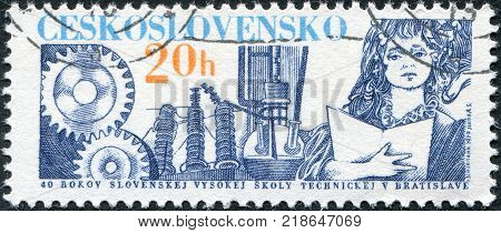 CZECHOSLOVAKIA - CIRCA 1979: A stamp printed in the Czechoslovakia, dedicated to 30th anniversary of the Slovak Technical University, shows Cog Wheels, Transformer and Student, circa 1979