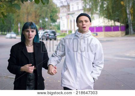 Traveling couple having a walk on the street