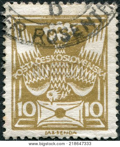 CZECHOSLOVAKIA - CIRCA 1920: A stamp printed in the Czechoslovakia shows the Carrier Pigeon with Letter circa 1920