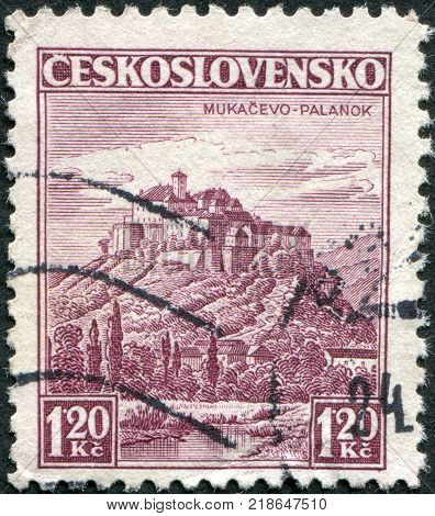 CZECHOSLOVAKIA - CIRCA 1936: A stamp printed in the Czechoslovakia represented Castle Palanok near Mukacevo circa 1936