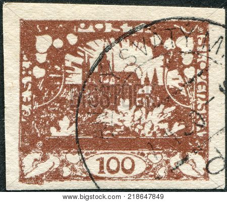 CZECHOSLOVAKIA - CIRCA 1919: A stamp printed in the Czechoslovakia, shown Hradchany (St. Vitus Cathedral) and St. Nicholas Church, Prague, circa 1919