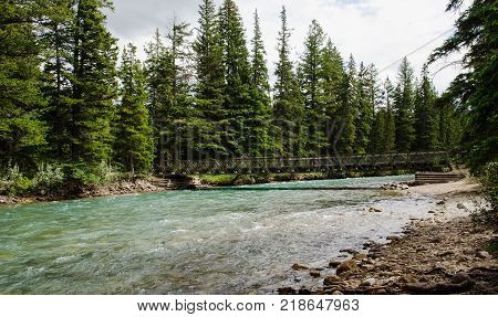 The 6th bridge of the Maligne Canyon just before the Maligne River enters the Athabasca River in Jasper Alberta Canada