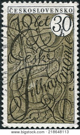 CZECHOSLOVAKIA - CIRCA 1966: A stamp printed in the Czechoslovakia is dedicated to the 70th anniversary of the Czech Philharmonic shown Symbolic Musical Instruments and Names of Composers circa 1966