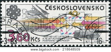 CZECHOSLOVAKIA - CIRCA 1983: A stamp printed in the Czechoslovakia dedicated to World Communications Year shows the different types of mail delivery: airmail road transport railway transport circa 1983