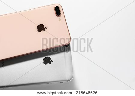 KIEV, UKRAINE - OCTOBER 23, 2017: Back panel of iPhone 8 Plus Gold and iPhone 6s Plus Silver on light background