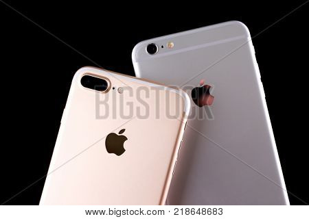 KIEV, UKRAINE - OCTOBER 19, 2017: Back panels of iPhone 7 Plus Gold and iPhone 6s Plus Silver  on black background