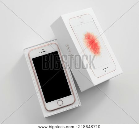 KIEV, UKRAINE - OCTOBER 17, 2017: Rose Gold iPhone SE in box on white background