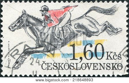 CZECHOSLOVAKIA - CIRCA 1978: A stamp printed in the Czechoslovakia Pardubice Steeplechase shows Hurdling circa 1978